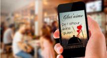 téléphone portable affichant le slogan du site de rencontre glut'aime
