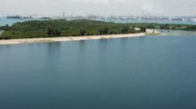 Une décharge publique devenue une île artificielle au large de Singapour