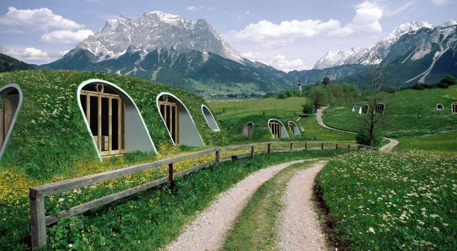 Vue paysage de plusieurs maisons de hobbit à la montagne